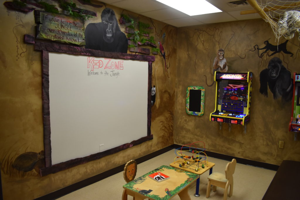Kid Zone Area at PCCEK with white board and games